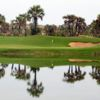 A view of a green with water coming into play at Mangais Golf Club