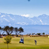 A view of hole #1 with mountains in background at Al Maaden Golf Resort