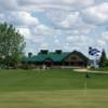 A view of a green and the clubhouse in background at Sylvan Lake Golf and Country Club