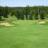 A view of hole #1 protected by sand traps at Smoky Lake Golf Club