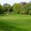 A view of the 5th green surrounded by trees at Kidderminster Golf Club