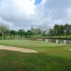 A view of the 3rd green protected by sand traps at Sibu Golf Club