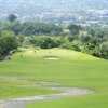 A view of a green protected by bunkers at Alta Vista Golf & Country Club