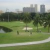 A view of a tee and a green at Club Intramuros
