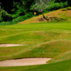 A view of a green protected by bunkers at Forest Hills Golf & Country Club