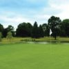 View of a green and pond at Cranbury Golf Club