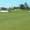 A view of the 1st green protected by bunkers at Barefoot Bay Golf & Recreation Park
