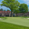 A view of a green flanked by tricky sand traps at Aronimink Golf Club