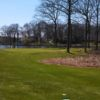 A view of a hole with water in background at Turkeyfoot Lake Golf Links