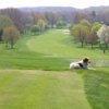 """A view of a fairway and the club's mascot """"Bunker"""" at Turkeyfoot Lake Golf Links"""