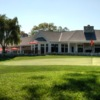 A view of a hole and the clubhouse in background at Ridgewood Country Club