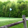 A view over a fence at Sugarbush Golf Course