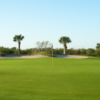 A view of a green with bunker at Viera East Golf Club