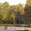 View of a green over water at River Plantation Country Club