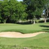 View of a green and bunker at Lost Creek Golf Course