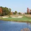 A view of a hole with water and bunkers coming into play at Wedgewood Golf & Country Club