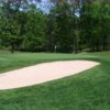 A view of a green protected by a bunker at Hill Nine from Silver Creek Country Club