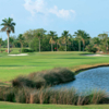 A view of a green flanked by sand traps at Gulf Stream Golf Course.