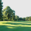 A sunny day view of a fairway at Sandy Burr Country Club