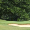 A view of a green protected by bunker at Willow Creek Golf Course