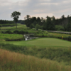 A view of a green with water coming into play at The Golf Club of New England