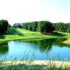 A view over a pond of fairway #8 at Towne Lake Hills Golf Club