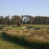 A view of a green defended by a collection of bunkers at Kokopelli Golf Course