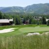 A view of a green protected by bunkers at Park Meadows Golf Club