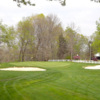 A view of the 5th green flanked by bunkers at Crawfordsville Country Club