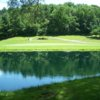 A view of a green with water coming into play at Elkader Golf & Country Club
