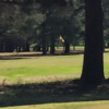 A sunny day view of a green at Wilson Lake Country Club