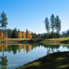 A view over the water of hole #7 at Trestle Creek Golf Course