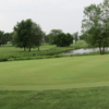 A view of a green with water in background at David City Golf Course
