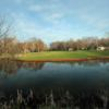 A view over the water of a hole from Royal at Canadian Lakes Country Club
