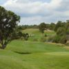 A view of green and fairway #13 at The Hideout Golf Club