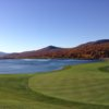 A fall view of a fairway from Stowe Mountain Club