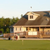 A view of the clubhouse and practice putting green at Partridge Run Golf & Country Club