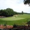 A view of a green and the tennis courts at Sedgewood Golf Club