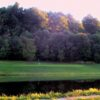 A view over the water of a green at Breezewood Golf Links