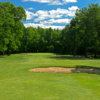 A view of a green protected by bunkers at Broadacres Golf Club