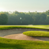 A view of a green protected by bunkers at Penfield Country Club