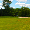 A view of a green protected by a bunker at Swan Lake Golf & Country Club