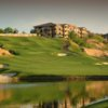 A view over the water of the 9th green at Wolf Creek Golf Club