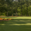 A view of a green protected by bunkers from the Golf Club at Cuscowilla