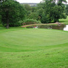 A green view with water in background at Huinganal Golf Club