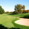 A view of a green protected by an undulating bunker at Milwaukee Country Club