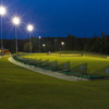 An evening view of the driving range tees at Knight's Play Golf Center