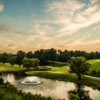A view of a green with water coming into play at Oakwoods Country Club