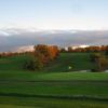 A view of a green with water coming into play at Hilltop Golf Course