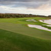 A view of a hole with water and bunkers coming into play at Eagle Course from TwinEagles Golf & Country Club